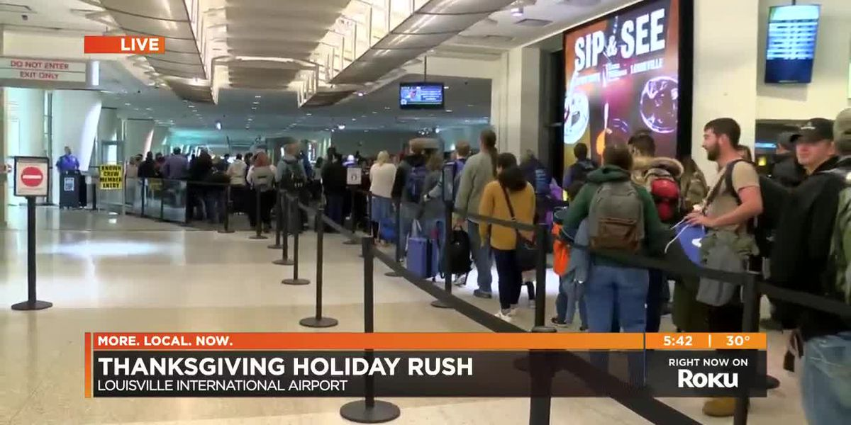 Thanksgiving travelers line up at Louisville International Airport