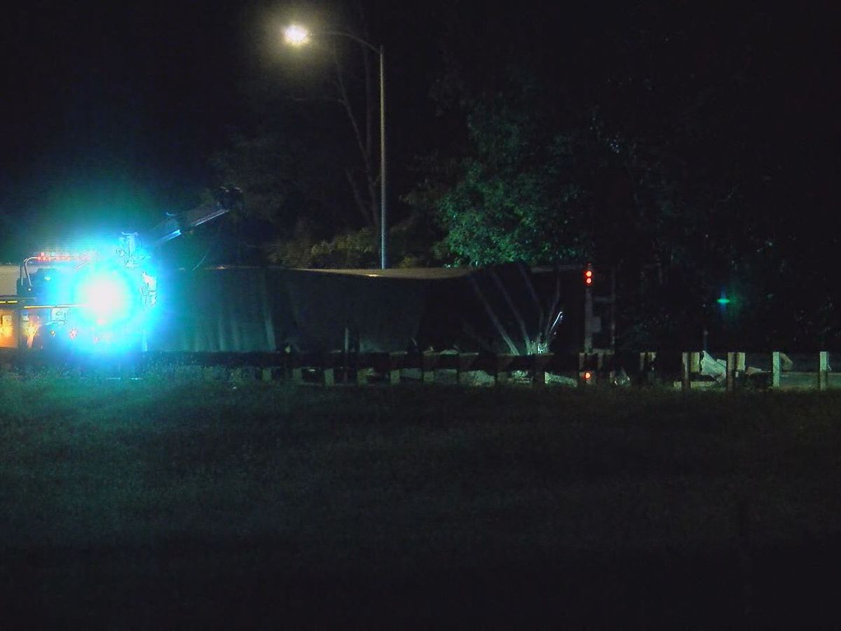 Overturned semi shuts down ramp to I-65