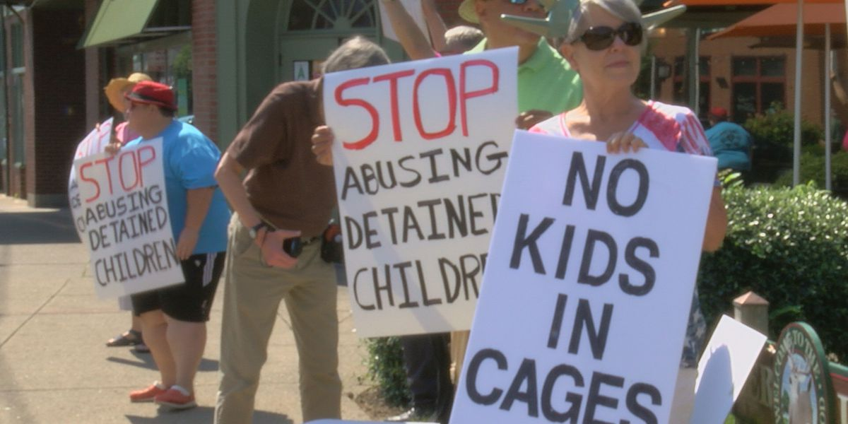 Demonstrators take to Bardstown Road for rally against reported treatment of migrant children