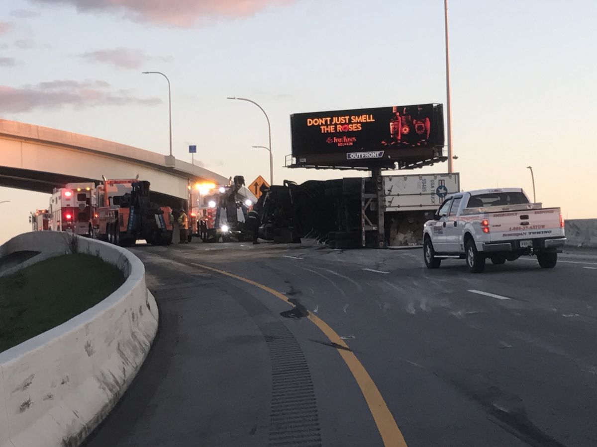 Overturned semi shuts down I-64 W ramp to I-65 S