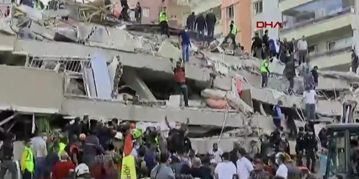 Raw: Rescuers respond to collapsed building after Turkey quake