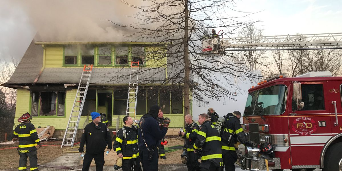 New Albany house fire kills woman