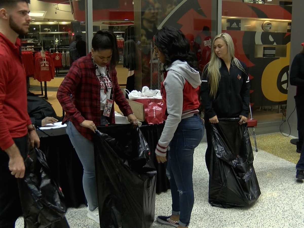 Cards basketball collecting toys for charity before Saturday's game