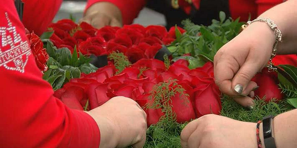 A late night for florists preparing coveted garland of roses
