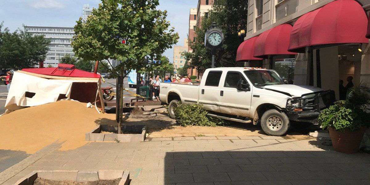 Truck crashes into Brown Hotel, 1 injured