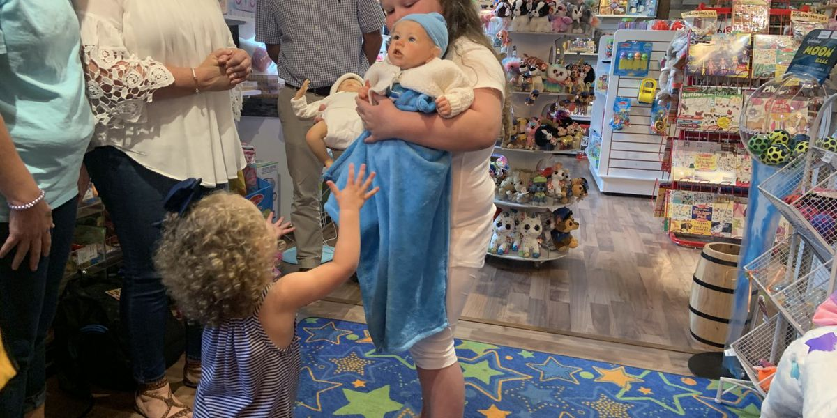 Make A Wish Foundation brings girl with brain tumor baby dolls