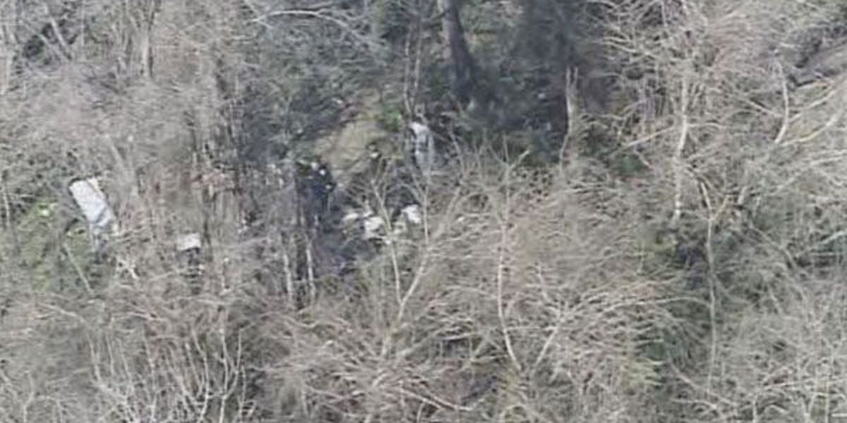 Body found in wooded area behind tire store