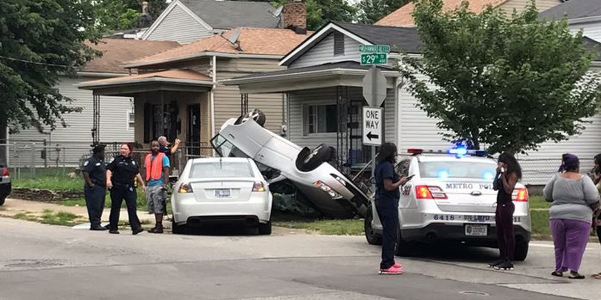 Crash ends with overturned car in yard in West Louisville