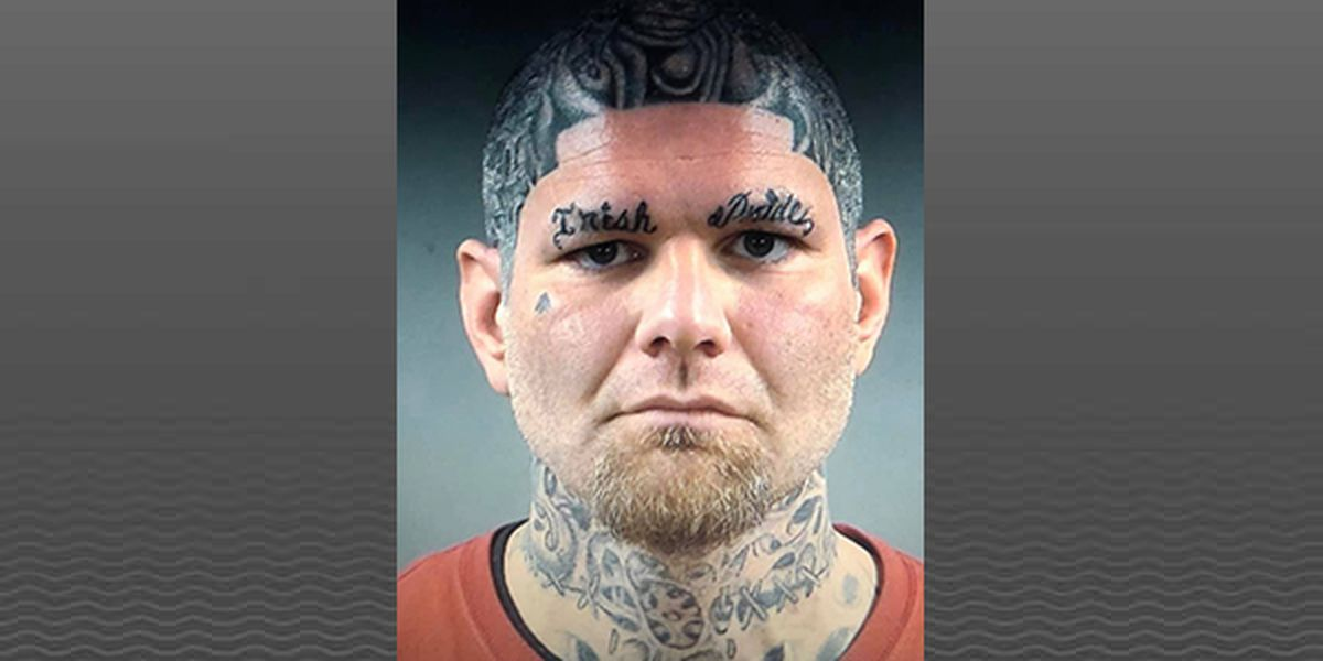 Wanted Kentucky man sports distinctive tattoos in mug shot