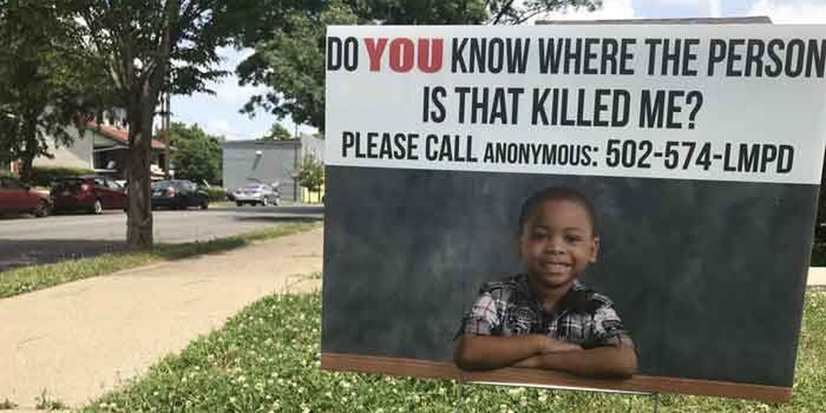 Signs ask for help finding 7-year-old's killer