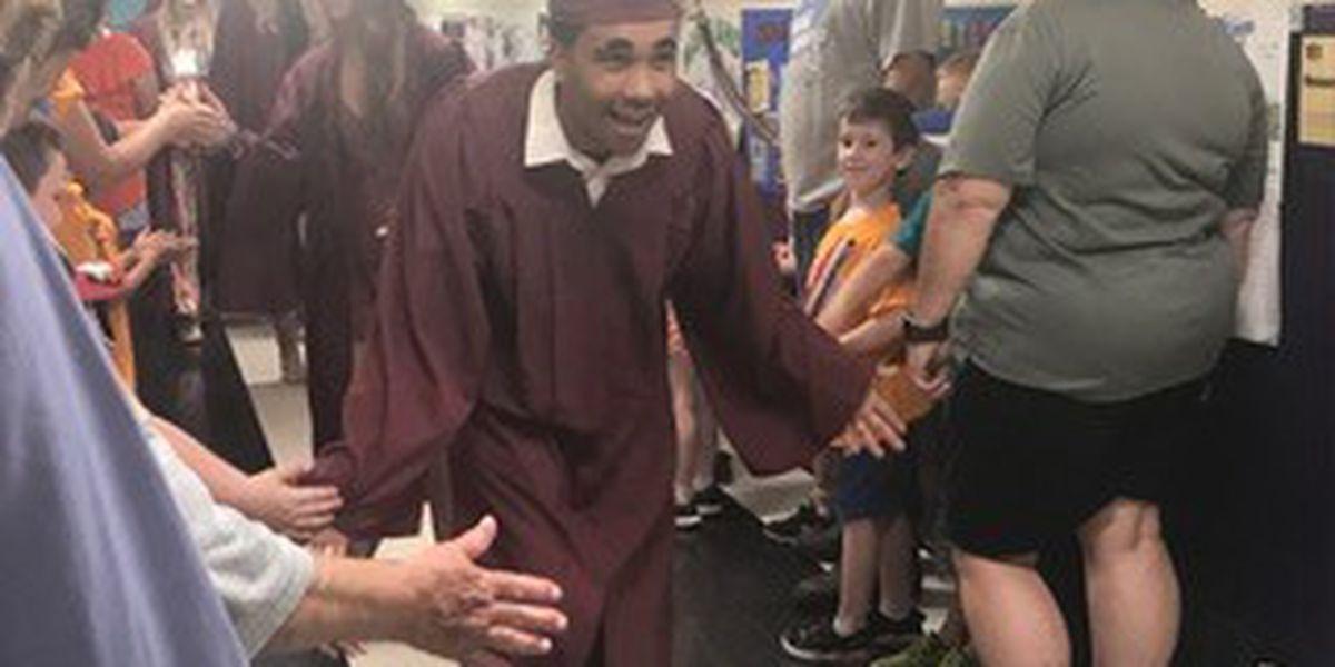 High school seniors walk the halls of elementary schools