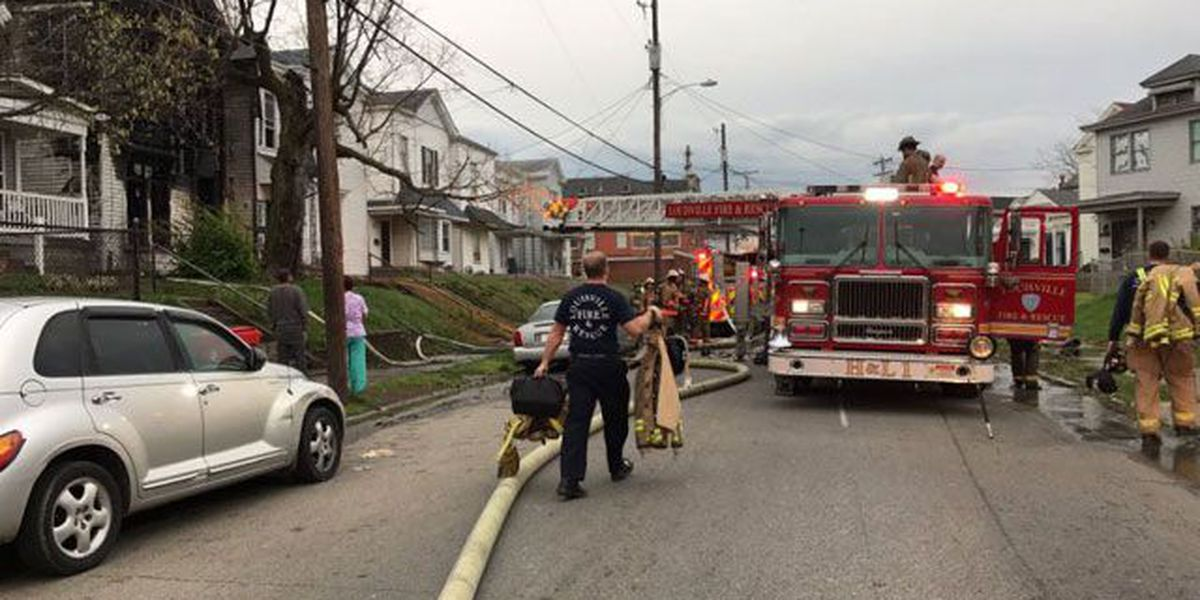 1 in custody after house fire in Portland neighborhood