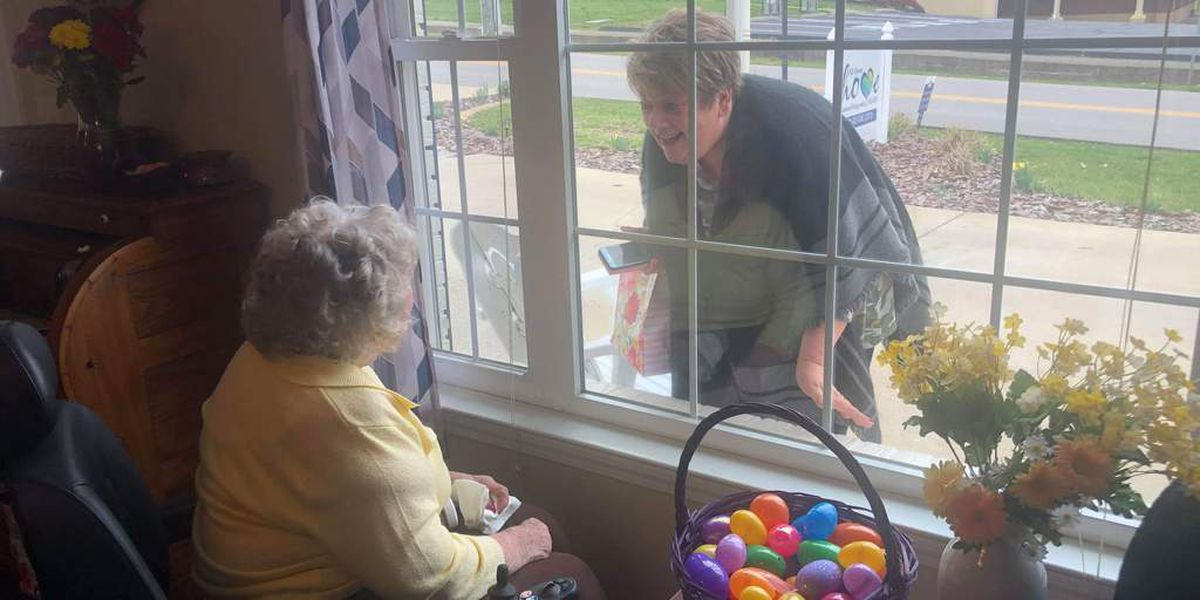 Separated by coronavirus restrictions, daughter shares 93-year-old mother's birthday through glass window