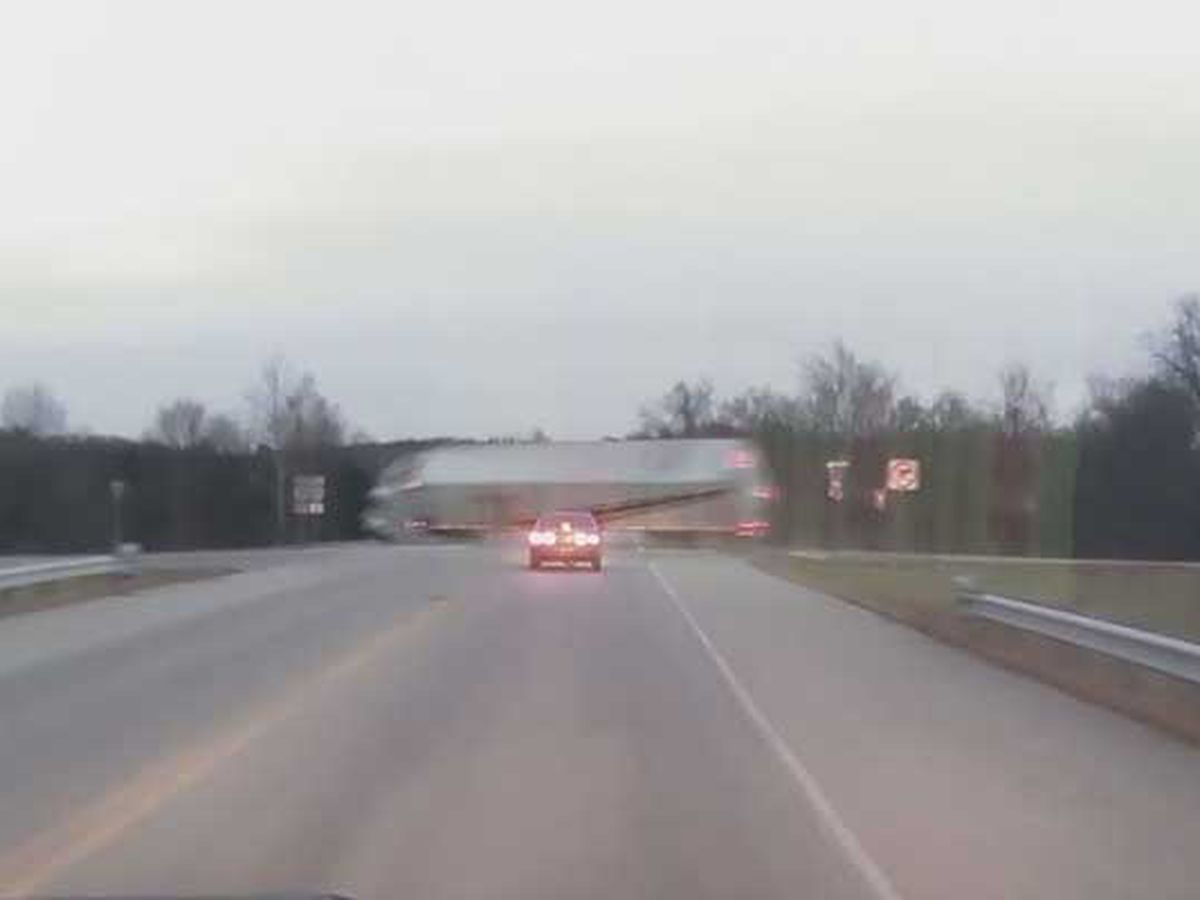 WATCH: Driver walks away from crazy, high speed semi crash