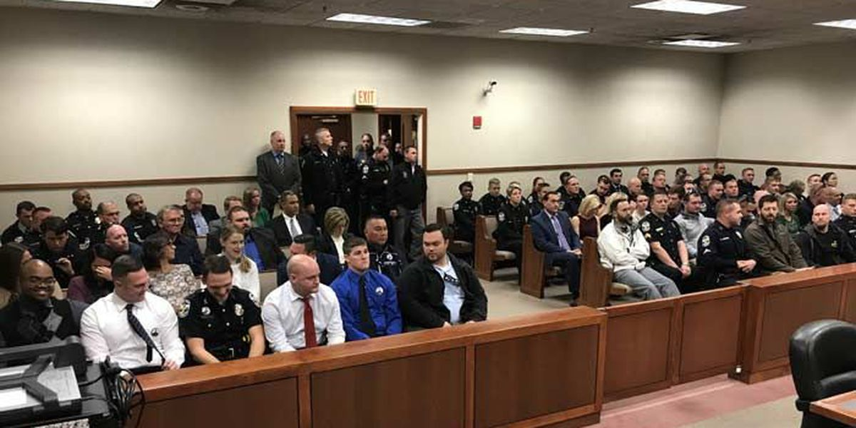 Heavy police presence at accused cop killer's court hearing