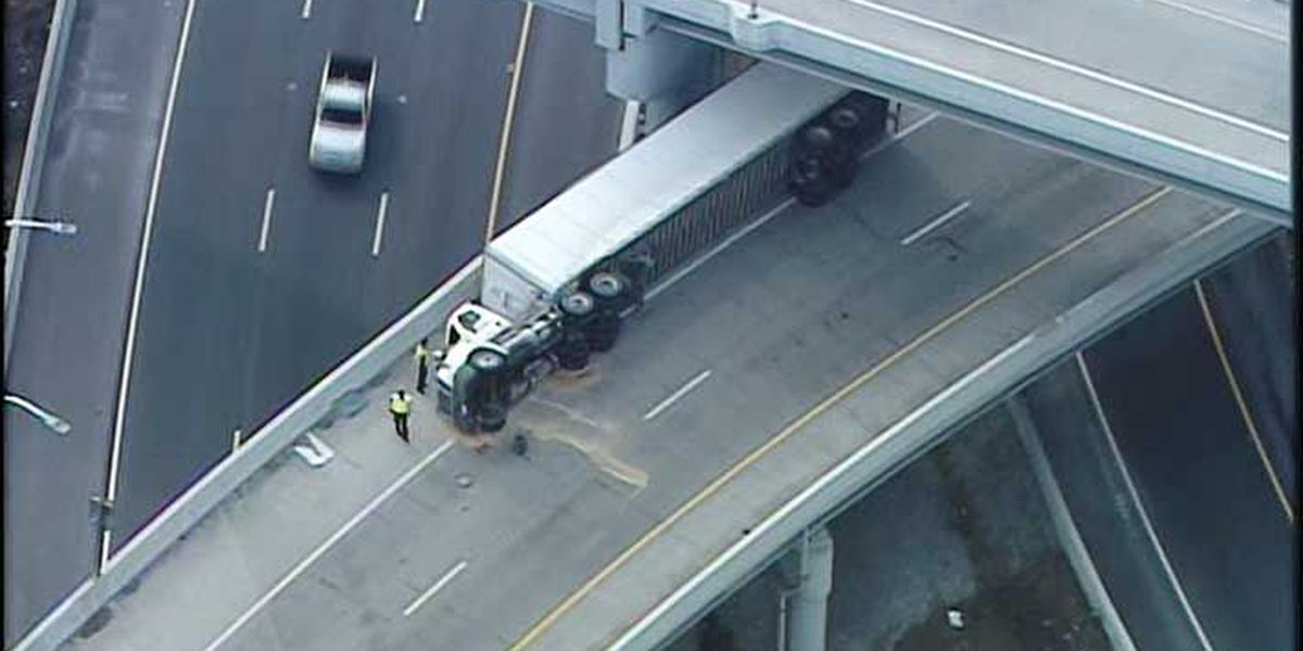 Downtown interstate ramp closed after semi overturns