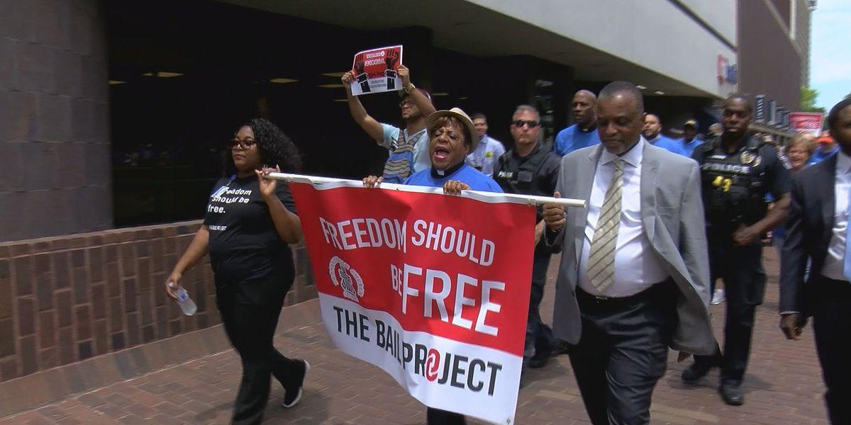 Demonstrators say cash bail is jail sentence to poor