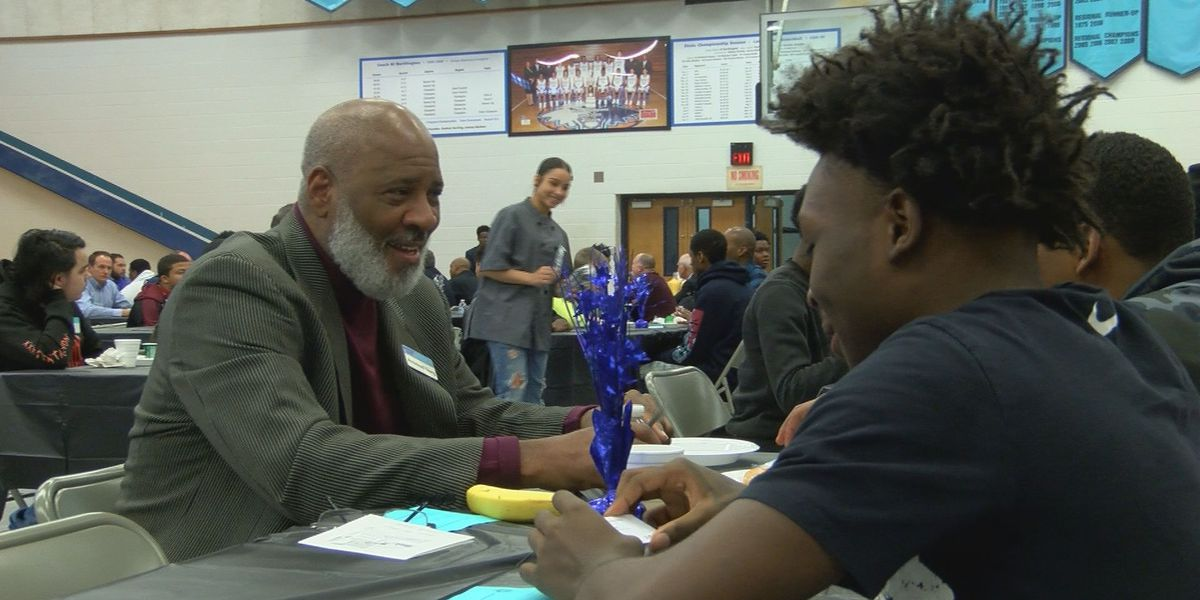 100 men attend breakfast at high school to mentor students