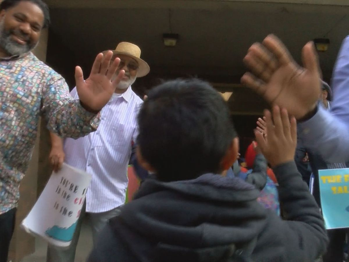 Flash Dads encourage students at Louisville elementary school