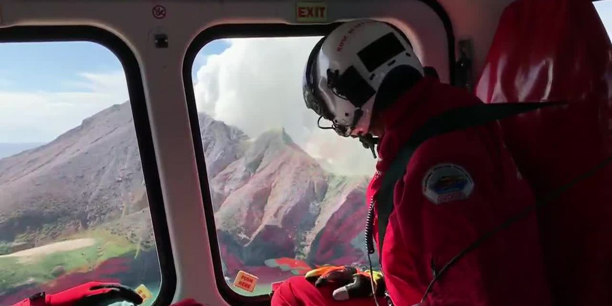 New Zealand volcano vents steam, stymies recovery of bodies