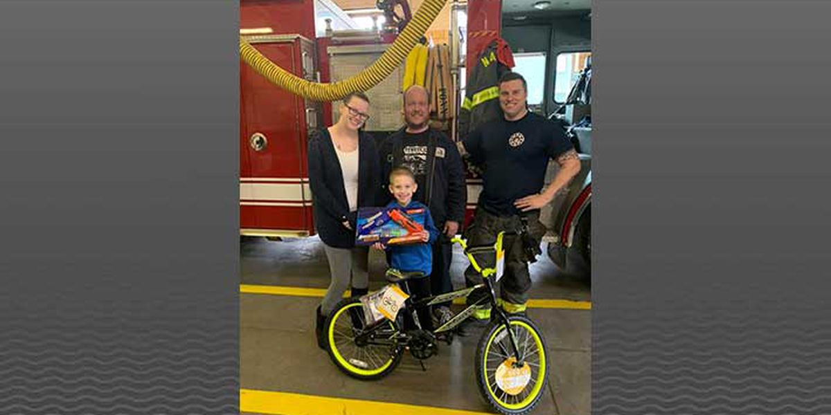 IN firefighters surprise fire victim with brand new bicycle