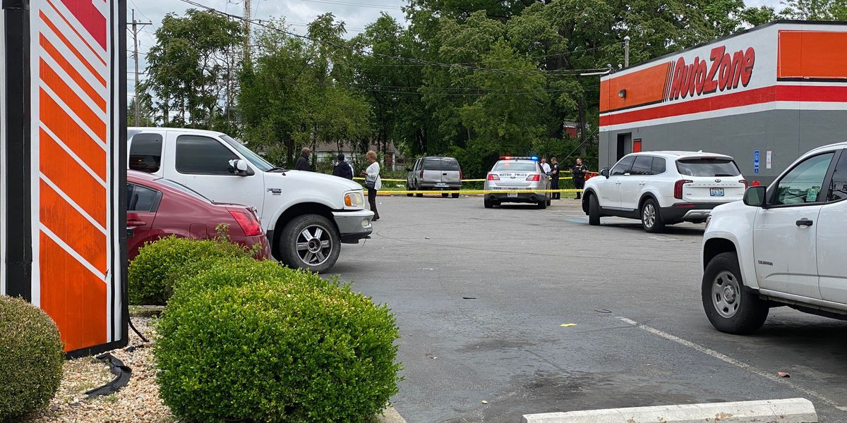 Man found shot in vehicle on lot of Russell neighborhood business