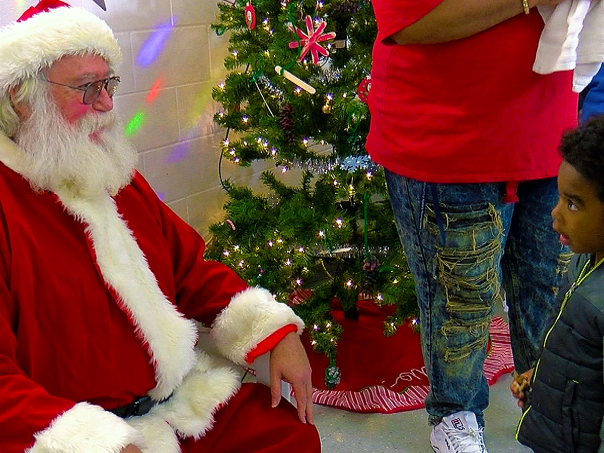 Santa stops by Riverside Towers for holiday party