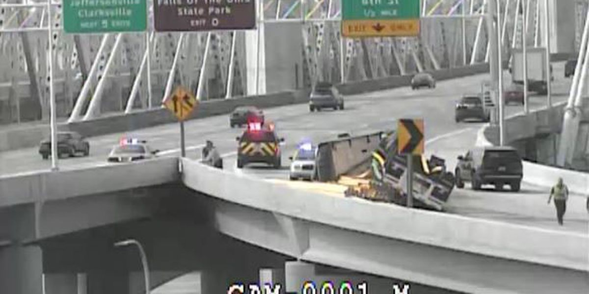 Rig hauling pipes overturns on I-64 ramp in downtown Louisville