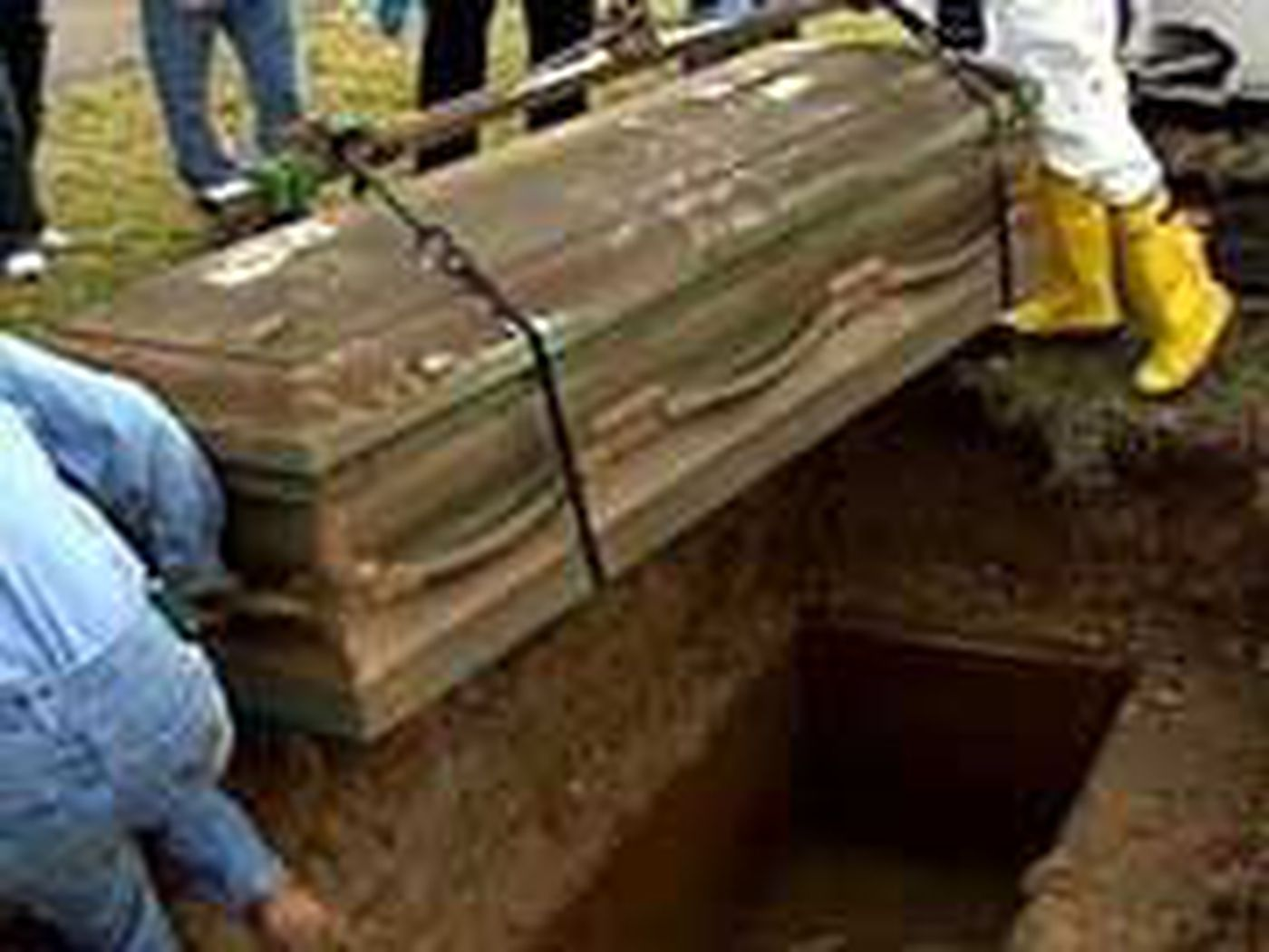 Families Have Bodies Exhumed From Waterlogged Crypts