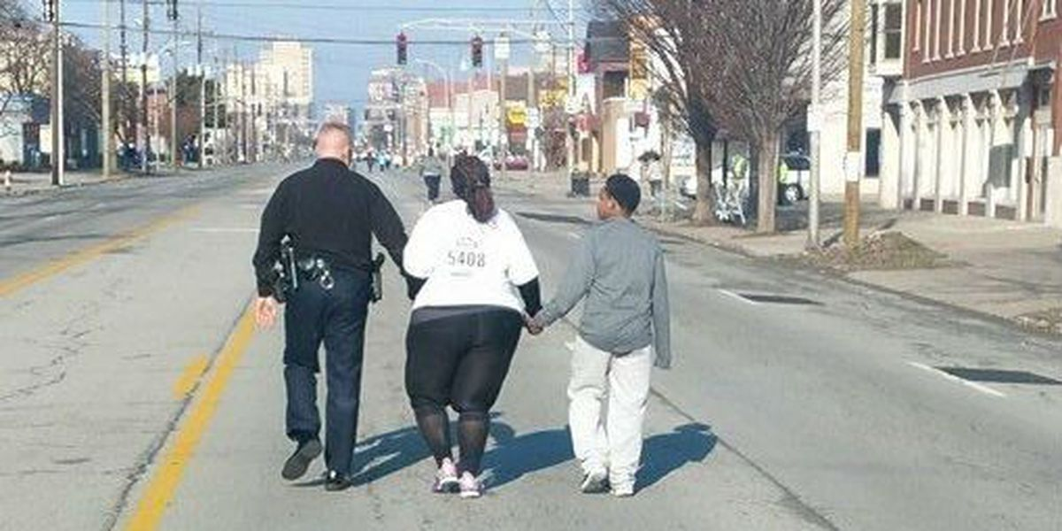 VIRAL PHOTO: Hand in hand, police and race participant cross finish line together
