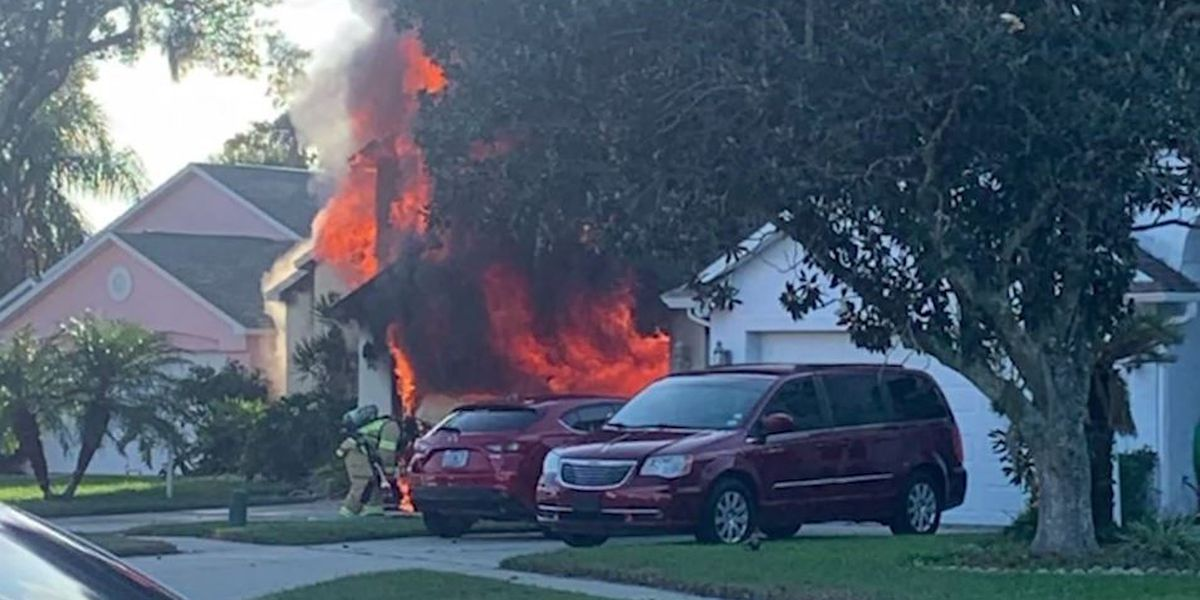 Amazon driver runs into burning Fla. home to rescue man