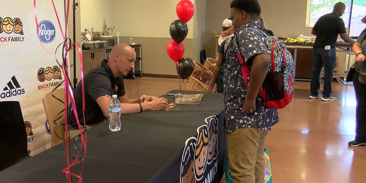 UofL head basketball coach gives school supplies to local kids