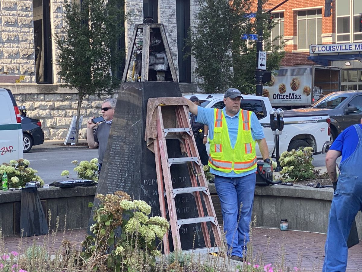 Protesters extinguish eternal flame at downtown police memorial
