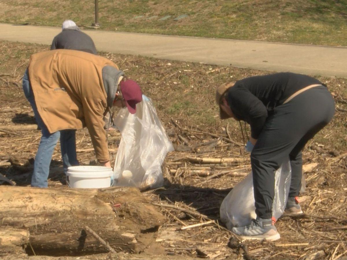 Volunteers at Waterfront Park clean up flood garbage