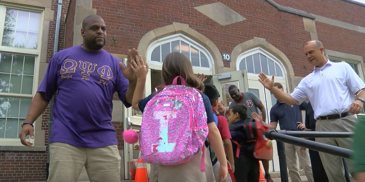 Flash Dads welcome students to Semple Elementary School