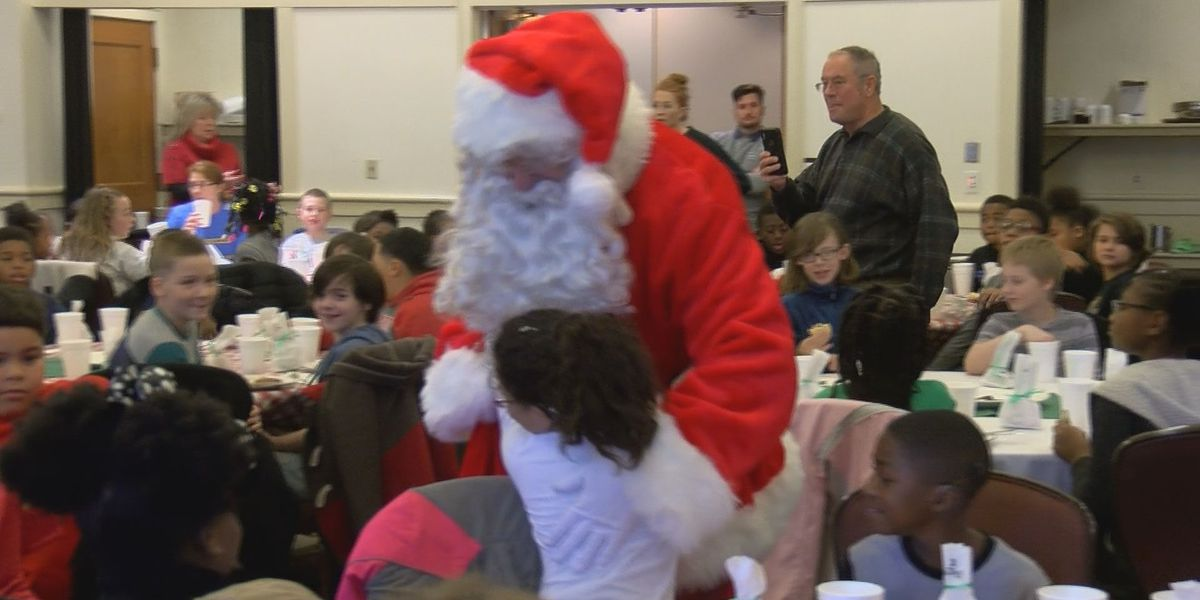 Elementary students gifted toys and meeting with Santa