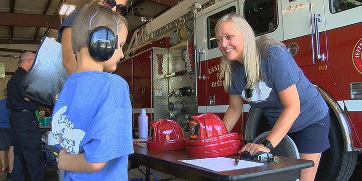 Firefighters reach out to children with autism spectrum disorder