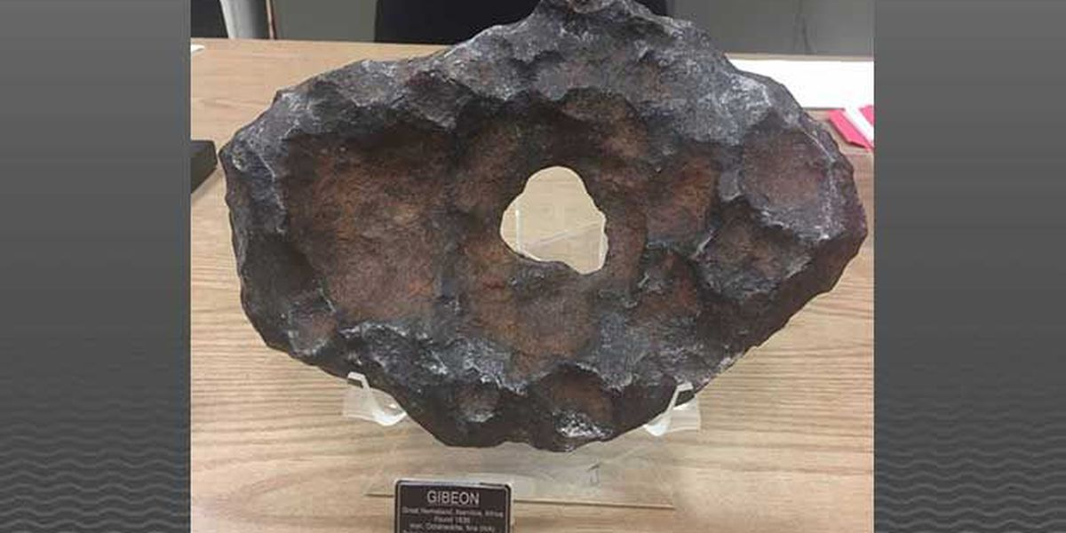 Visitors can touch meteorites at new planetarium exhibit