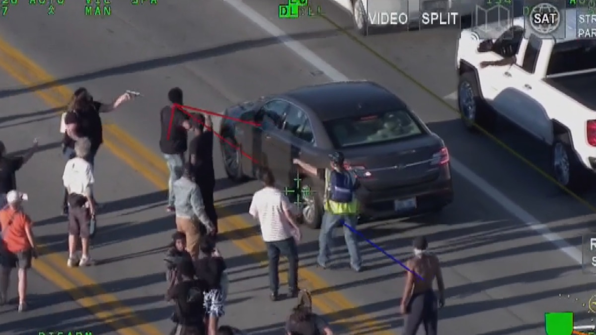 Witnesses say protester, driver pointed guns at each other in east end