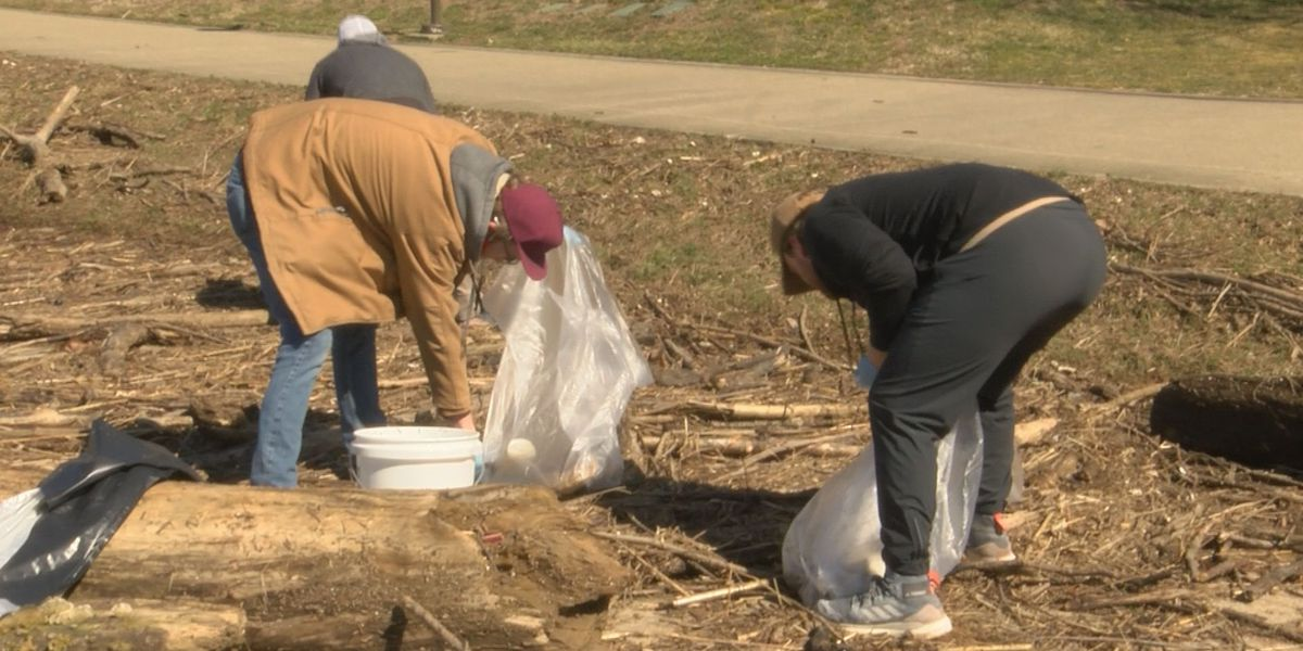 Volunteers at Waterfront Park clean up flood garbage