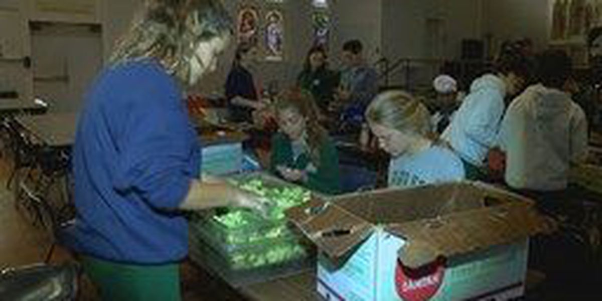 Holy Trinity students visit Louisville charities to give back on Halloween