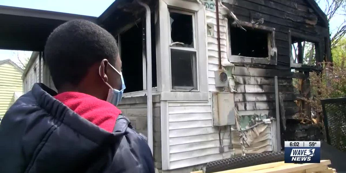Teenage boy helps family escape as neighboring home catches fire