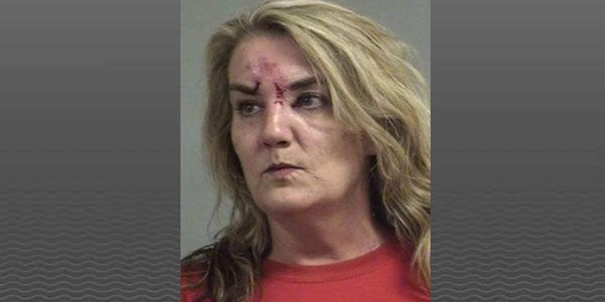 Woman charged with DUI after crashing into home
