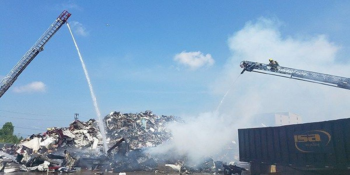 Crews battle fire at Okolona recycling facility
