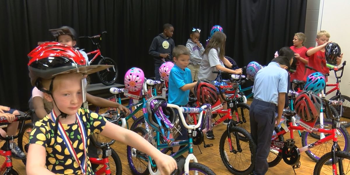 Students with perfect attendence surprised with new bikes at Coral Ridge Elementary