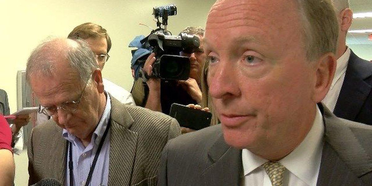 RAW VIDEO: UofL interim president swarmed by reporters following Frankfort testimony