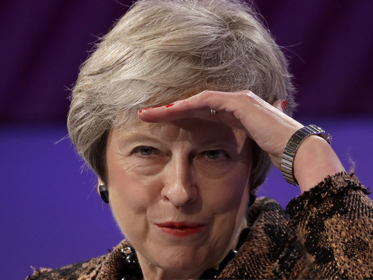 May gets rebellion reprieve, but faces warning from allies