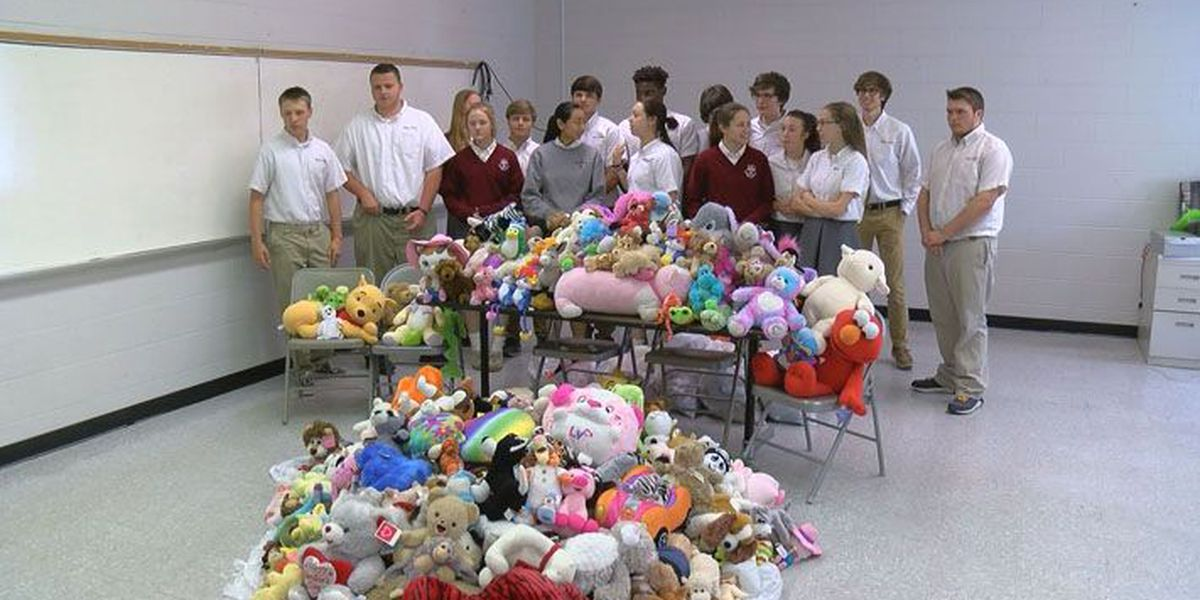 Holy Cross honors Officer Nick Rodman with stuffed animal collection