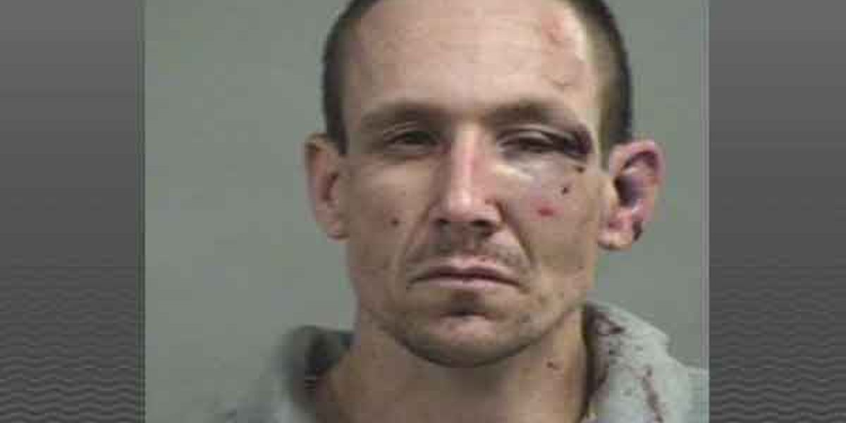 Man charged with robbing, shooting Louisville clergyman