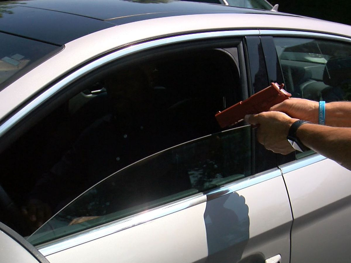Security expert shows how to react during an attempted carjacking